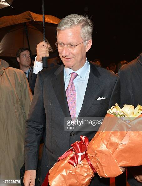 This picture taken on June 20 2015 shows King Philippe of Belgium arrives in the rain in Wuhan central China's Hubei province to kick off his...