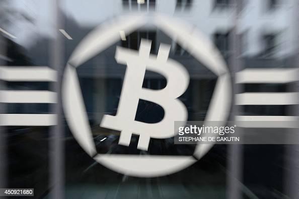 This picture taken on June 20 shows an entrance of La Maison du Bitcoin in Paris AFP PHOTO / STEPHANE DE SAKUTIN