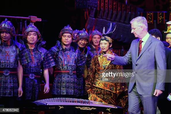 This picture taken on June 21 2015 shows King Philippe of Belgium meeting Chinese opera performers after a show in Wuhan central China's Hubei...