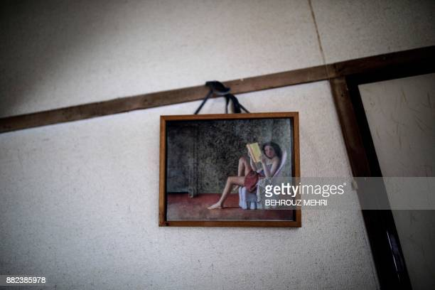 This picture taken on June 21 shows a print of 'Katia reading' painting by Balthus hung on the wall of a woman who died alone and left for about two...