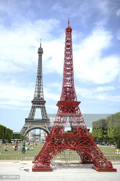 This picture taken on June 23 2014 shows a repliqua of the Eiffel Tower set near the real one and designed by French designer of outdoor furniture...