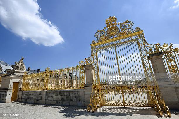 This picture taken on June 24 2014 shows the royal gate of the Chateau de Versailles in Versailles France AFP PHOTO / BERTRAND GUAY