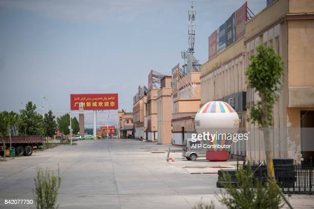 This picture taken on June 25 2017 shows an empty street in Guangzhou New City a 15 million square metre 'urban centre' on the outskirts of Kashgar...