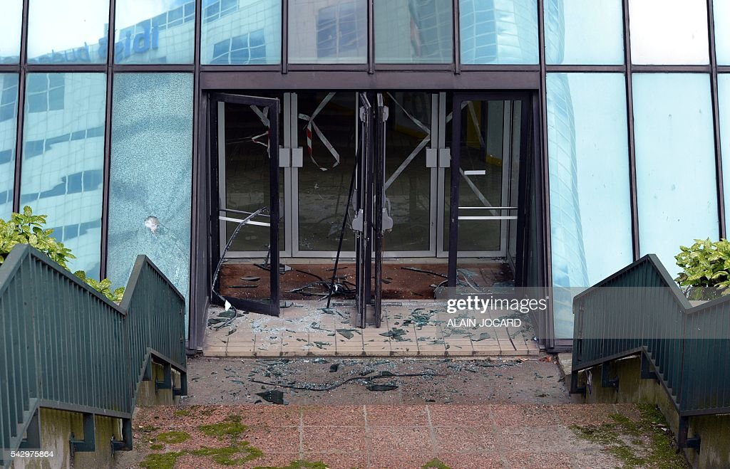 This picture taken on June 25, 2016, in Paris, shows the French General Confederation of Labour (confederation generale du travail, CGT) building's main entrance after it was vandalized last night by unindentified people. / AFP / ALAIN