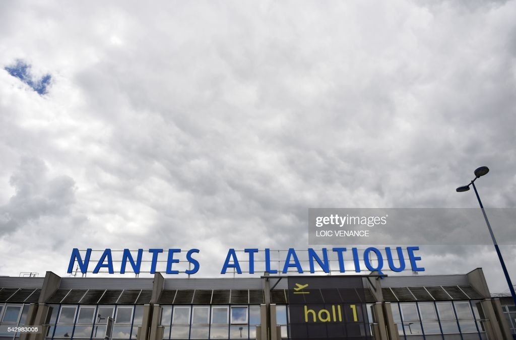 This picture taken on June 25, 2016, shows the entrance of the Nantes-Atlantique airport in Bouguenais, suburb of Nantes, the day before a local referendum in Loire Atlantique to transfer the Nantes Atlantique airport to Notre-Dame-des-Landes. / AFP / LOIC