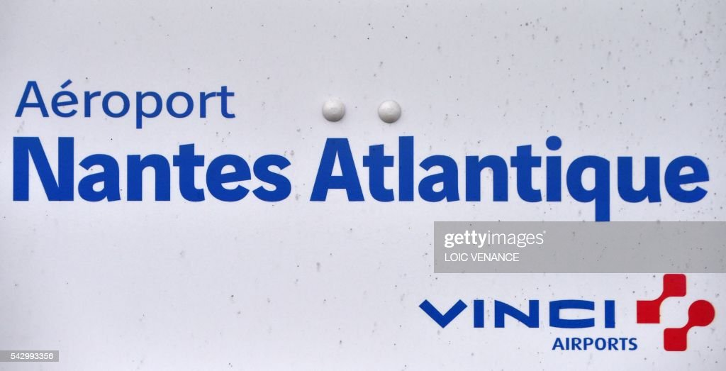 This picture taken on June 25, 2016, shows the logo of the Nantes-Atlantique airport operated by Vinci airports in Bouguenais, suburb of Nantes, the day before a local referendum in Loire Atlantique to transfer the Nantes Atlantique airport to Notre-Dame-des-Landes. / AFP / LOIC