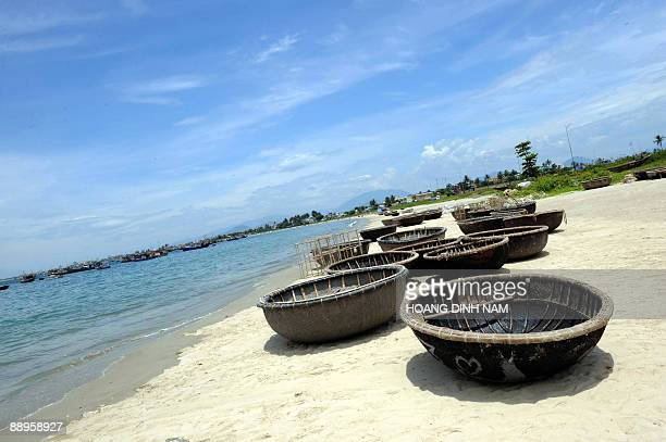 This picture taken on June 26 2009 shows bamboo fishing boats lying on a beach in the central coastal city of Da Nang Vietnam demanded the 'immediate...