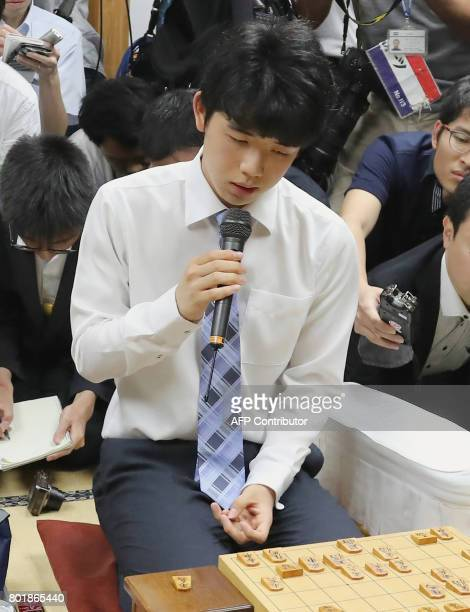 This picture taken on June 26 2017 shows junior high school student Sota Fujii speaking in Tokyo after breaking a 30yearold record with his 29th...