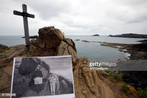 This picture taken on June 27 2017 shows a postcard with Priest Foure close to 'Les rochers sculptés' carved rocks in SaintMalo western France...