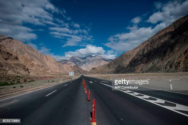 This picture taken on June 27 2017 shows the ChinaPakistan Friendship Highway before the Karakorum mountain range near Tashkurgan in China's western...