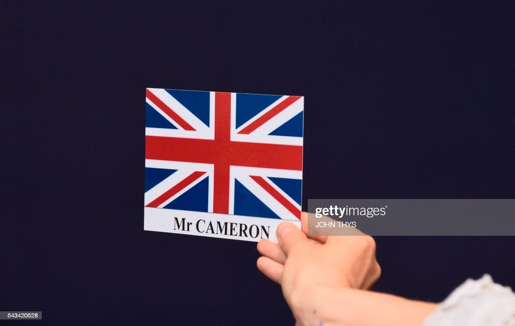 This picture taken on June 28, 2016, shows a sticker representing the Union jack, flag of United Kingdom, and the name of Britain's Prime Minister David Cameron during EU - Summit at the EU headquarters in Brussels on June 28, 2016. Prime Minister David Cameron said Tuesday he wants the 'closest possible' relations with the EU after Britain voted to leave the bloc, adding the split should be 'as constructive as possible'. As he arrived at a Brussels summit, Cameron, who is to step down within weeks, told reporters that, while Britain was leaving the EU, 'we mustn't be turning our backs on Europe.' THYS