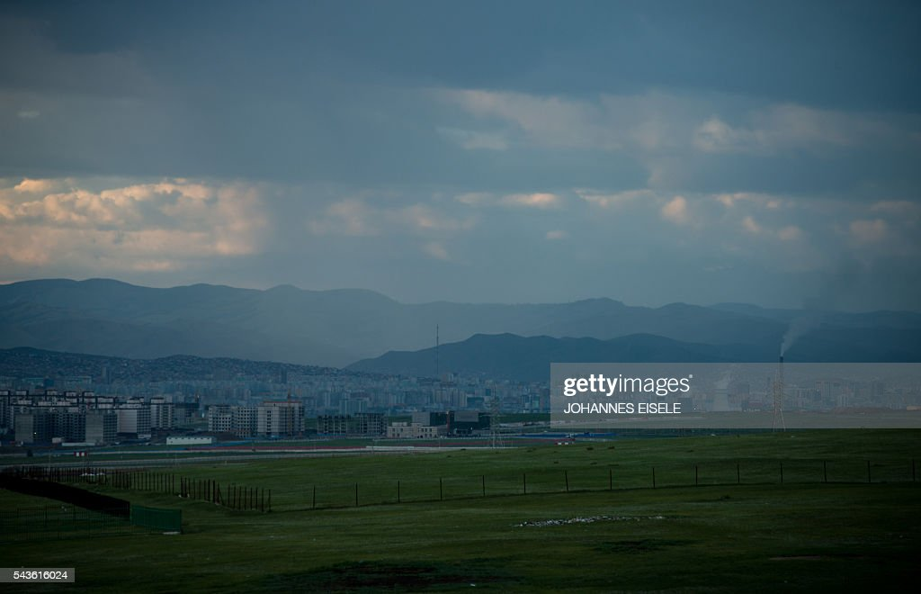 This picture taken on June 29, 2016 shows the cityscape of Ulan Bator. Mongolians went to the polls across their sprawling, sparsely-populated country on June 29 as it struggles to benefit from its vast natural resources amid disputes over foreign investment and slumping demand from neighbouring China. It took Mongolian nomad Pagvajaviin Shatarbaatar seven days to get to his polling station to vote in in the general election -- accompanied by more than 2,000 sheep, goats and horses. EISELE