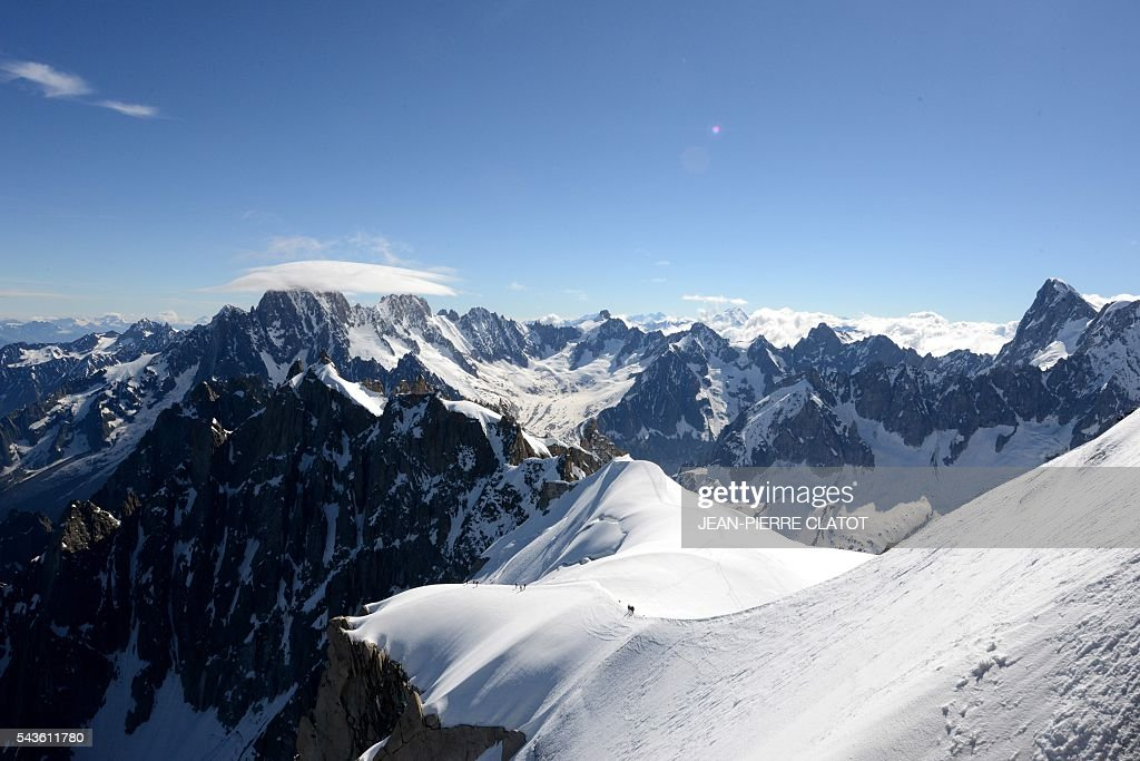 This picture taken on June 29, 2016 shows the Mont-Blanc peak at the top of the Aiguille du Midi (3842m) mountain above the vallee blanche, in the French Alps. / AFP / JEAN