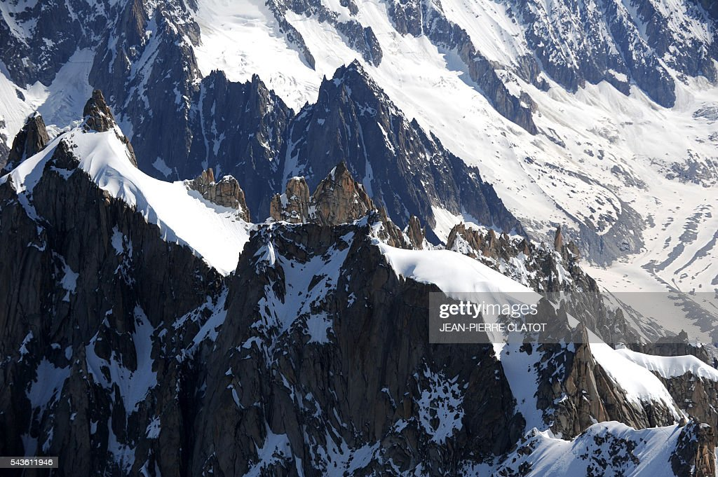 This picture taken on June 29, 2016 shows the Mont-Blanc peak at the top of the Aiguille du Midi (3842m) mountain above the vallee blanche, French Alps. / AFP / JEAN