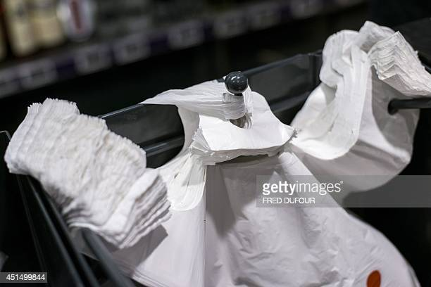 This picture taken on June 30 2014 in Paris shows plastic bags in a supermarket A governmental amendment added to the biodiversity bill on June 25...