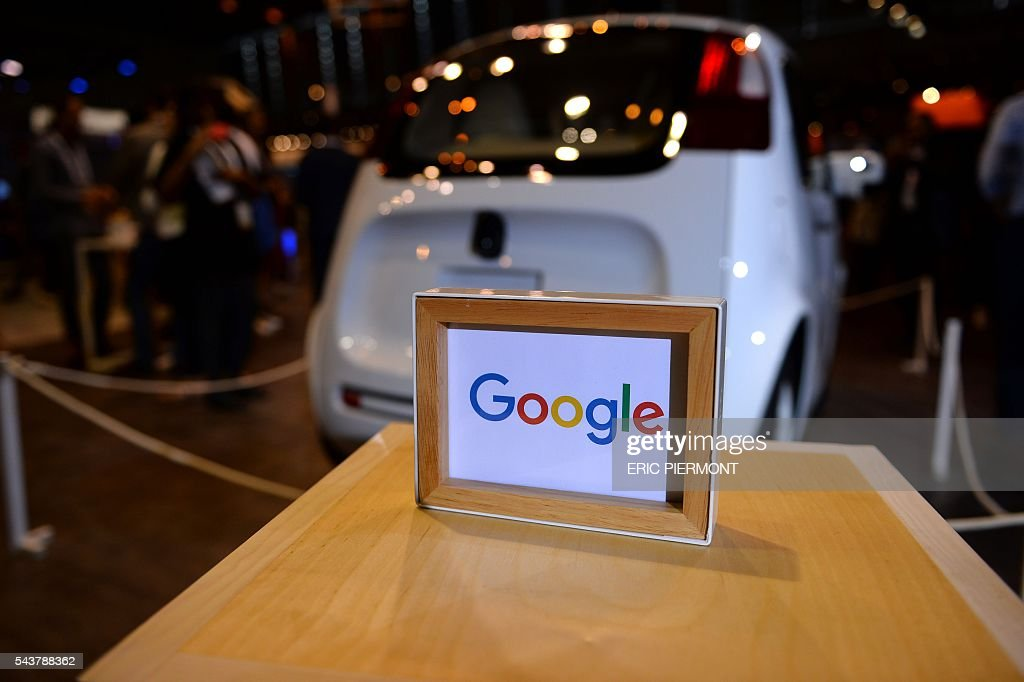 This picture taken on June 30, 2016 shows the Google's self driving car project on the Google stand at the Viva technology event in Paris. / AFP / ERIC