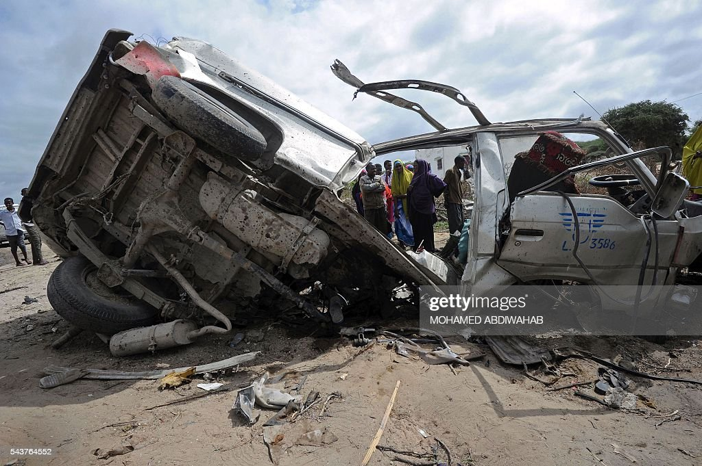 This picture taken on June 30, 2016, in Afgooye shows the wreckage of a minibus ripped by a bomb. A roadside bomb ripped apart a minibus just outside Somalia's capital Mogadishu on Thursday, killing at least eight people and injuring several others, a witness said. 'There was a terrible incident, a landmine hit a civilian minibus,' said Mohamed Wedow, a witness at the scene near the town of Afgooye. 'At least eight people died and more than 20 others were wounded in the blast.' ABDIWAHAB