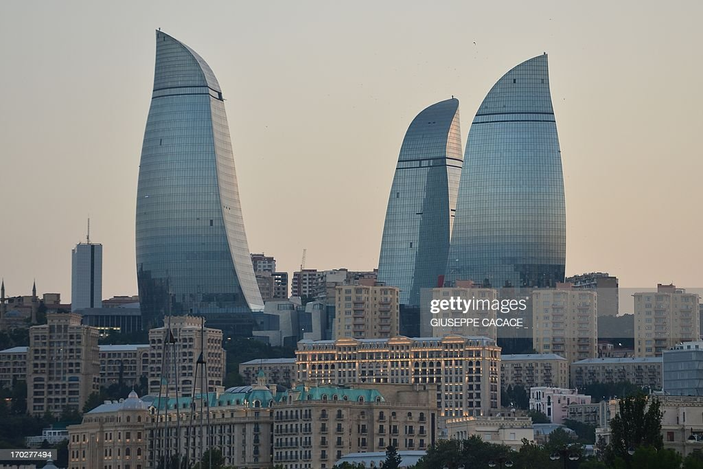This picture taken on June 5 2013 a panoramic view of Baku and the Flame Towers AFP PHOTO / GIUSEPPE CACACE