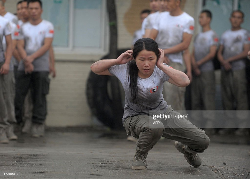 This picture taken on June 6, 2013 shows trainees taking part in a special bodyguard training session known as 'VIP Protection Training Camp' at Genghis Security Academy in Beijing. More than 70 trainees take part in more than 20-hours of intensive exercises including martial arts and evasive driving. CHINA OUT AFP PHOTO