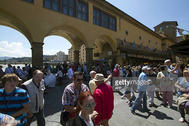 This picture taken on June 6 2013 shows visitors walking past the Corridoio Vasariano the Vasari corridor in Florence The Corridoio Vasariano the...