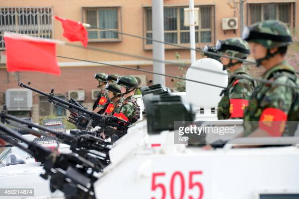 This picture taken on June 6 2014 shows security forces participating in a military drill in Hetian northwest China's Xinjiang regionChina vowed a...
