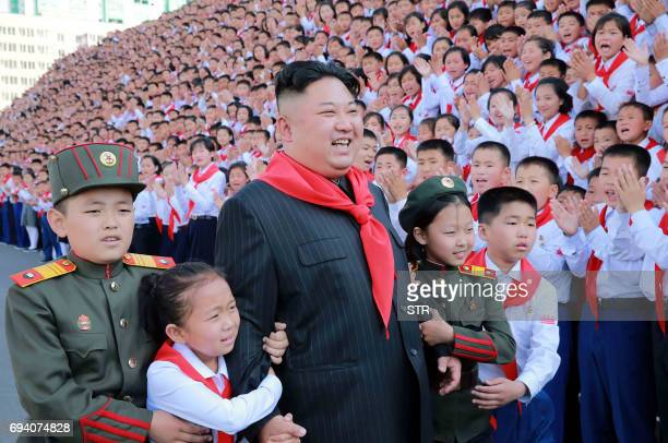 This picture taken on June 6 2017 and released from North Korea's official Korean Central News Agency on June 9 shows North Korean leader Kim JongUn...