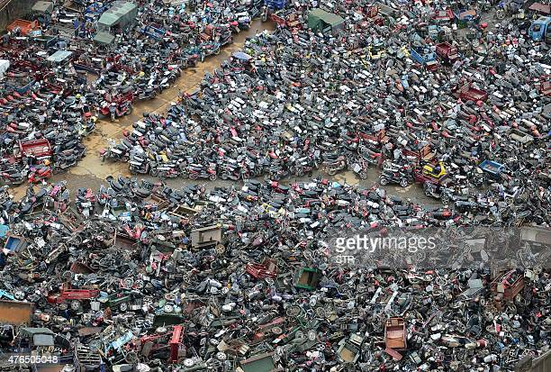 This picture taken on June 9 2015 shows a general view of an area full of abandoned motorcycles in Chenzhou central China's Hunan province China's...