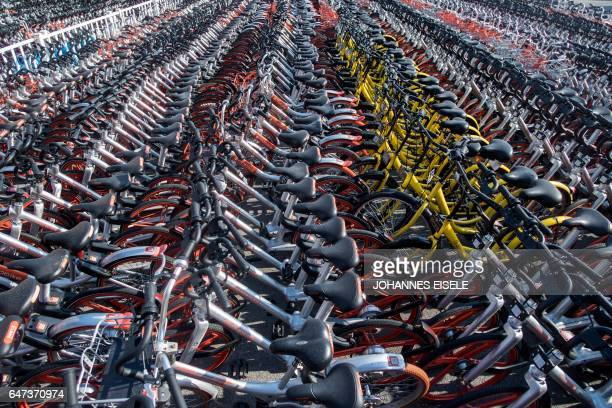 This picture taken on March 1 2017 shows impounded bicycles from the bikesharing schemes Mobike and Ofo in Shanghai Shanghai has impounded thousands...