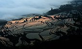 This picture taken on March 11 2012 shows the terraced rice fields in Hani southwest China's Yunnan province Japan's Mount Fuji a series of ancient...