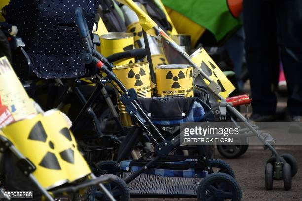 This picture taken on March 11 shows strollers pushed by anti nuclear activists as they take part in the commemoration of the nuclear disaster in...