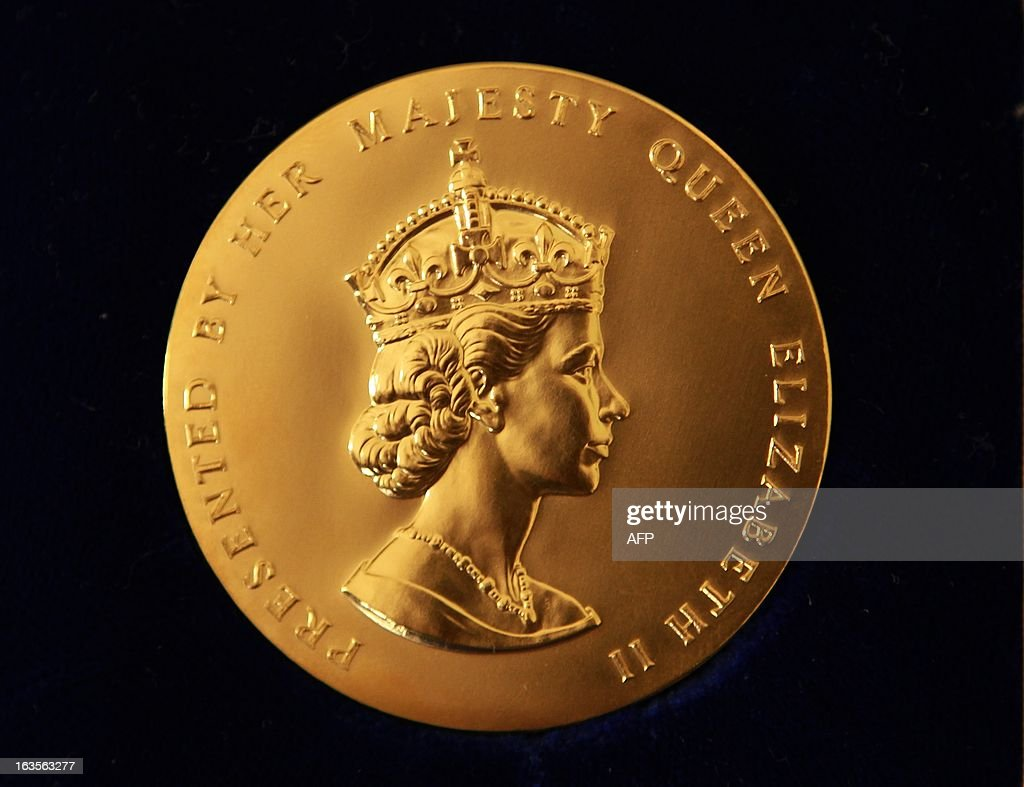 This picture taken on March 12, 2013 shows the obverse side of the Queen's Gold Medal for Poetry displayed before presentation at Buckingham Palace in London on March 12, 2013. AFP PHOTO/POOL/ Sean Dempsey