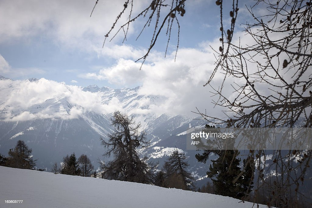This picture taken on March 13, 2013 above Saint-Luc, in the Swiss canton of Valais, shows the valley where 28 persons died in a traffic accident a year ago. A ceremony in memory of the 22 Belgian school children and six adults killed in a horrific bus accident in the Swiss Alps will take place on the one-year anniversary of the tragedy near the accident site. The small town of Sierre in the southern canton of Valais announced on its website on February 21 that it would host the ceremony at 6:00 pm (1700 GMT) on March 13 at the town church, a year after the Belgian bus smashed into the wall of a nearby Alpine tunnel at 100 kilometres (65 miles) an hour.