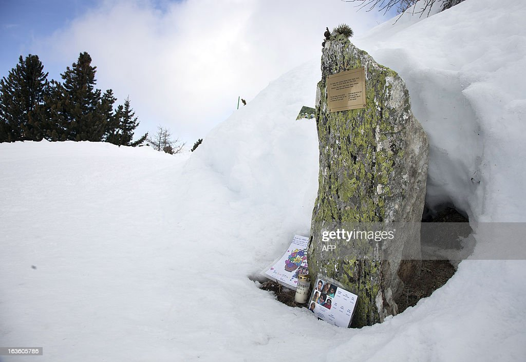 This picture taken on March 13, 2013 above Saint-Luc, in the Swiss canton of Valais, shows a commemorative plaque bearing the name of the persons who died in a traffic accident a year ago. A ceremony in memory of the 22 Belgian school children and six adults killed in a horrific bus accident in the Swiss Alps will take place on the one-year anniversary of the tragedy near the accident site. The small town of Sierre in the southern canton of Valais announced on its website on February 21 that it would host the ceremony at 6:00 pm (1700 GMT) on March 13 at the town church, a year after the Belgian bus smashed into the wall of a nearby Alpine tunnel at 100 kilometres (65 miles) an hour.
