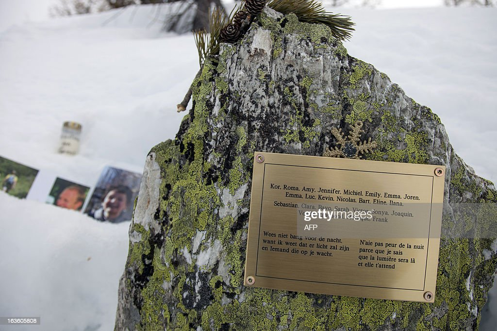 This picture taken on March 13, 2013 above Saint-Luc, in the Swiss canton of Valais, shows a commemorative plaque bearing the name of the persons who died in a traffic accident a year ago. A ceremony in memory of the 22 Belgian school children and six adults killed in a horrific bus accident in the Swiss Alps will take place on the one-year anniversary of the tragedy near the accident site. The small town of Sierre in the southern canton of Valais announced on its website on February 21 that it would host the ceremony at 6:00 pm (1700 GMT) on March 13 at the town church, a year after the Belgian bus smashed into the wall of a nearby Alpine tunnel at 100 kilometres (65 miles) an hour. AFP PHOTO / BORIS HEGER
