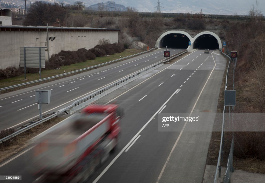 This picture taken on March 13, 2013 in Sierre, in the Swiss canton of Valais, shows the exit of the tunnel in which 28 people died a year ago. A ceremony in memory of the 22 Belgian school children and six adults killed in a horrific bus accident in the Swiss Alps will take place on the one-year anniversary of the tragedy near the accident site. The small town of Sierre in the southern canton of Valais announced on its website on February 21 that it would host the ceremony at 6:00 pm (1700 GMT) on March 13 at the town church, a year after the Belgian bus smashed into the wall of a nearby Alpine tunnel at 100 kilometres (65 miles) an hour. AFP PHOTO / BORIS HEGER