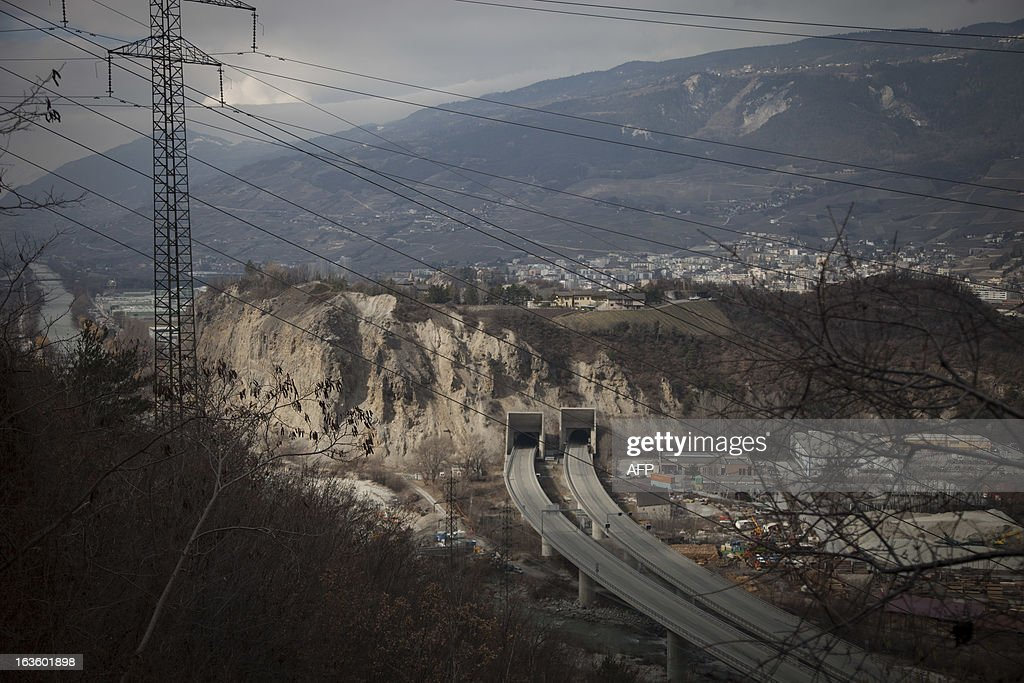 This picture taken on March 13, 2013 in Sierre, in the Swiss canton of Valais, shows the entrance of the tunnel in which 28 people died a year ago. A ceremony in memory of the 22 Belgian school children and six adults killed in a horrific bus accident in the Swiss Alps will take place on the one-year anniversary of the tragedy near the accident site. The small town of Sierre in the southern canton of Valais announced on its website on February 21 that it would host the ceremony at 6:00 pm (1700 GMT) on March 13 at the town church, a year after the Belgian bus smashed into the wall of a nearby Alpine tunnel at 100 kilometres (65 miles) an hour.