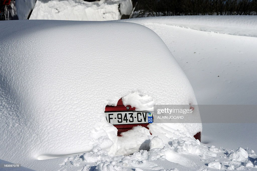 This picture taken on March 13, 2013 shows a car's registration plate as cars are blocked by snow on the D901 (secondary road 901) near Beaumont-Hague, northwestern France. More than 68,000 homes were without electricity in France and hundreds of people were trapped in their cars after a winter storm hit with heavy snow, officials and weather services said on March 12. Twenty-six regions in northwest and northern France were put on orange alert because of heavy snowfalls, which Meteo France said were 'remarkable for the season because of the expected quantity and length of time'.