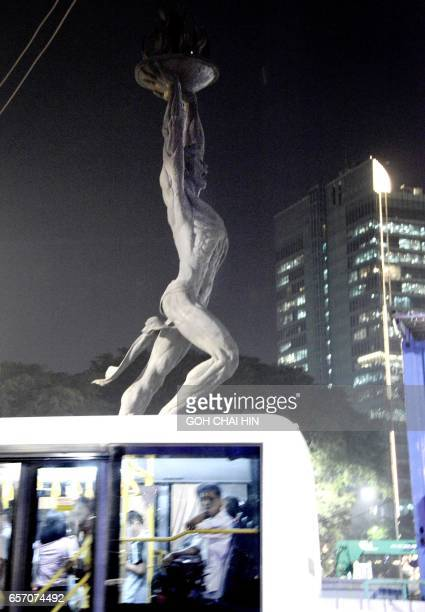 This picture taken on March 13 2017 shows the iconic Pemuda Membangun statue a 249 meter Sovietstyle darkgrey terrazzo statue dubbed the Pizza Man...