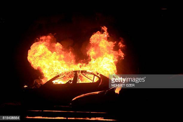 This picture taken on March 13 shows a burning car after a blast in Ankara An explosion ripped through a busy square in central Ankara on March 13...
