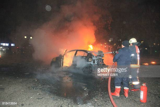 This picture taken on March 13 shows firefighters extinguishing a burning car after a blast in Ankara An explosion ripped through a busy square in...