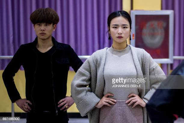 This picture taken on March 14 2017 shows Jiang Mengna attending a dance class at the Yiwu Industrial Commercial College in Yiwu east China's...