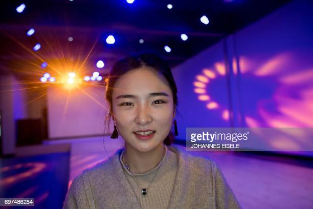 This picture taken on March 14 2017 shows Jiang Mengna posing for a picture during a class at the Yiwu Industrial Commercial College in Yiwu east...
