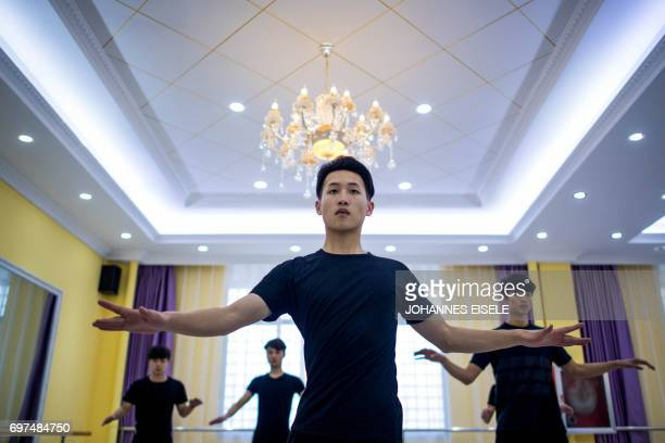 This picture taken on March 14 2017 shows Li Zhishu attending a dance class at the Yiwu Industrial Commercial College in Yiwu east China's Zhejiang...