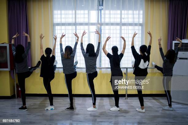 This picture taken on March 14 2017 shows students attending a dance class at the Yiwu Industrial Commercial College in Yiwu east China's Zhejiang...