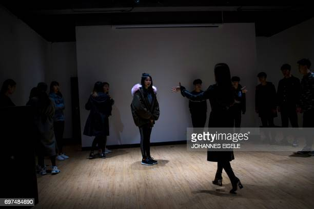 This picture taken on March 14 2017 shows Wang Xin attending a modelling class at the Yiwu Industrial Commercial College in Yiwu east China's...