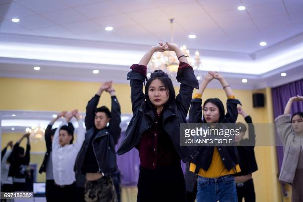 This picture taken on March 14 2017 shows Wang Xin attending a dance class at the Yiwu Industrial Commercial College in Yiwu east China's Zhejiang...