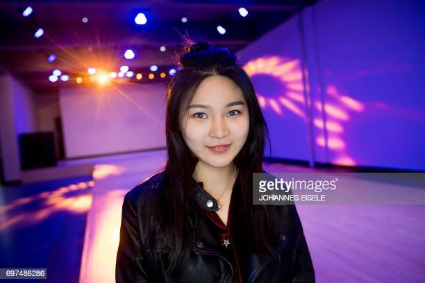 This picture taken on March 14 2017 shows Wang Xin posing for a picture during a class at the Yiwu Industrial Commercial College in Yiwu east China's...