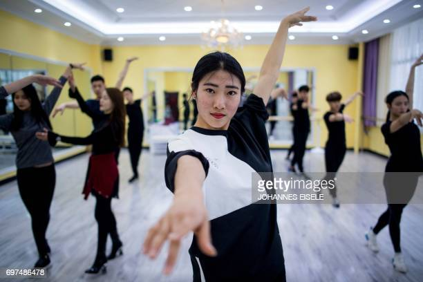This picture taken on March 14 2017 shows Zhang Yuying attending a dance class at the Yiwu Industrial Commercial College in Yiwu east China's...