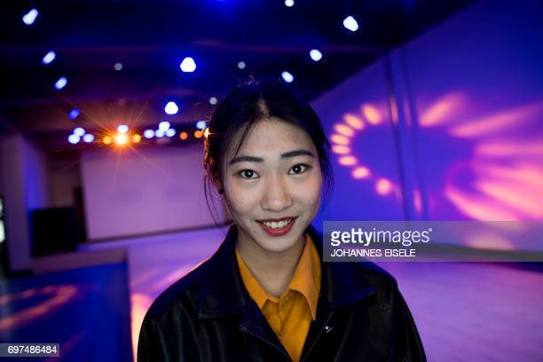 This picture taken on March 14 2017 shows Zhang Yuying posing for a picture during a class at the Yiwu Industrial Commercial College in Yiwu east...