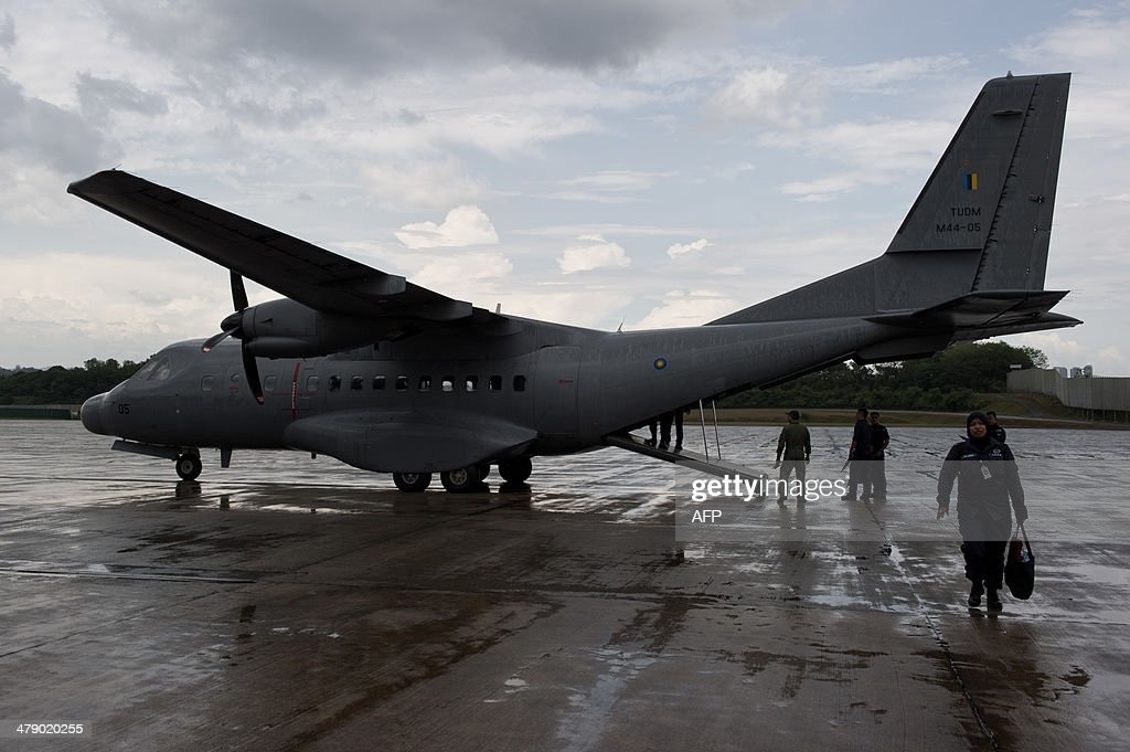 This picture taken on March 15, 2014 shows a Malaysian Air Force CN235 aircraft are seen on the tarmac during a search and rescue (SAR) operation to find the missing Malaysia Airlines flight MH370 plane over the Strait of Malacca in Subang. The disappearance of a Malaysia Airlines passenger jet is a potential disaster for a national flag carrier already struggling to cauterise severe financial hemorrhaging in the face of intensifying industry competition, raising the spectre of costly lawsuits and a drop in bookinngs.